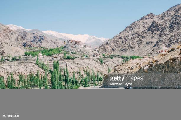 Ladakh, India: Motorcycle travels on mountain road from Likir village in Indus Valley