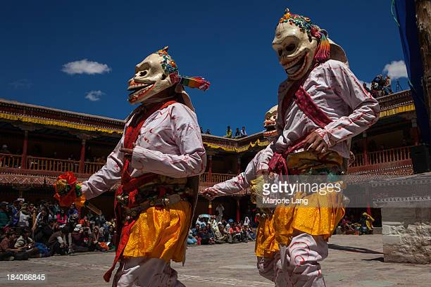 Ladakhi Buddhist monks dressed in folkloric costumes with masks are dancing at the annual Tsechu festival in Hemis gompa, Ladakh, Jammu and Kashmir,...