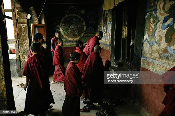 Ladakhi Buddhist monks remove their shoes before entering the main prayer hall during the morning prayer and chanting session at the Thiksey...