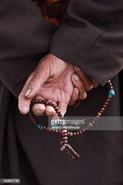 Ladakhi man holding prayer beads