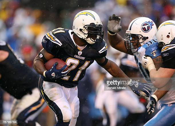 LaDanian Tomlinson of the San Diego Chargers runs for yardage against the Tennessee Titans in the second half during their AFC Wild Card Playoff Game...