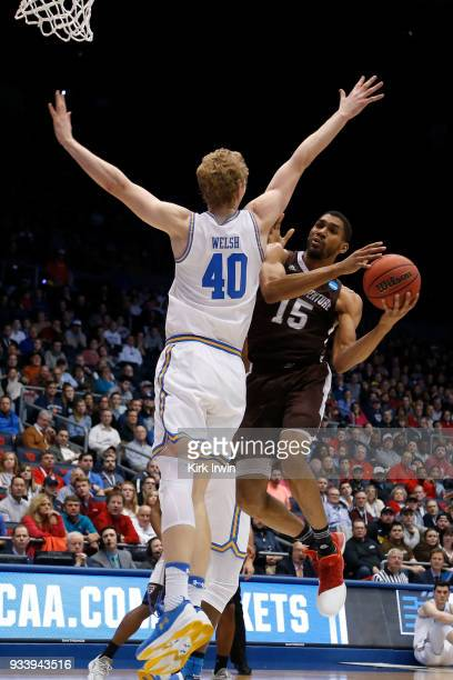 LaDarien Griffin of the St Bonaventure Bonnies attempts to shoot the ball over the defense of Thomas Welsh of the UCLA Bruins during the game at UD...