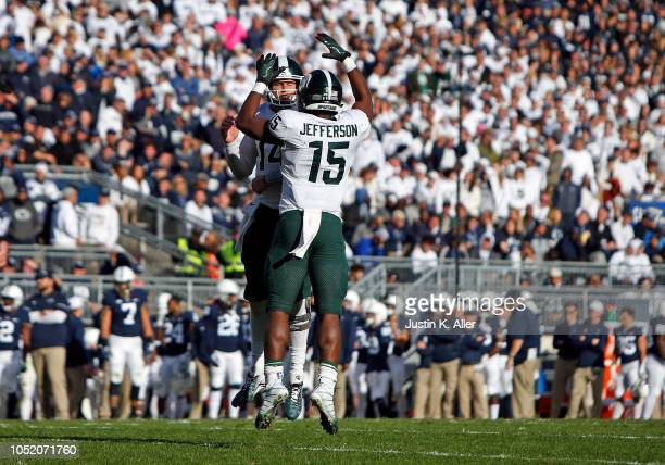 La'Darius Jefferson of the Michigan State Spartans celebrates with Brian Lewerke after scoring a 1 yard touchdown in the first half against the Penn...