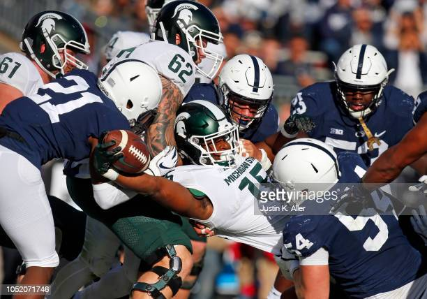 La'Darius Jefferson of the Michigan State Spartans reaches for a 1 yard touchdown in the first half against the Penn State Nittany Lions on October...