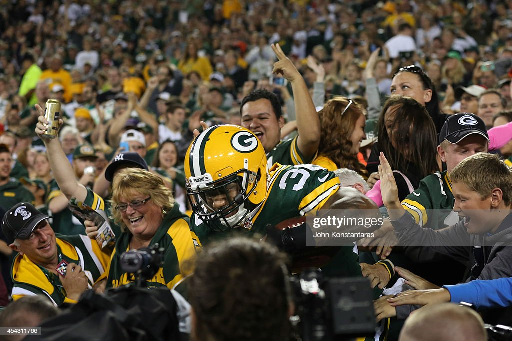 LaDarius Perkins #36 of the Green Bay Packers jumps into the crowd after scoring in the third quarter against the Kansas City Chiefs during the preseason game on August 28, 2014 at Lambeau Field in Green Bay, Wisconsin.