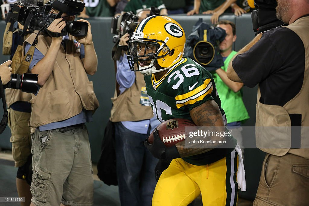 LaDarius Perkins #36 of the Green Bay Packers runs back to the field after jumping in the crowd after scoring in the third quarter against the Kansas City Chiefs during the preseason game on August 28, 2014 at Lambeau Field in Green Bay, Wisconsin.