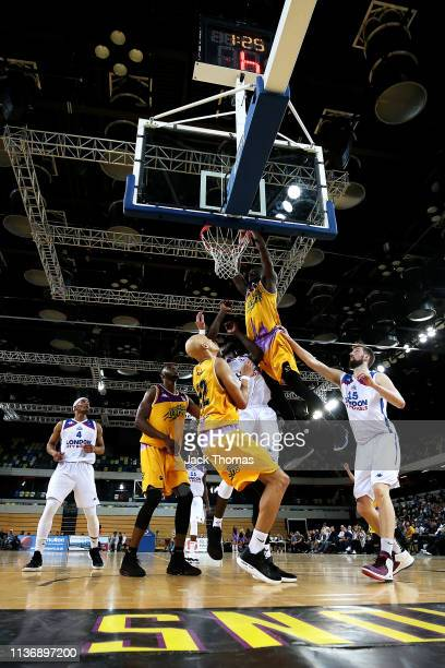 Ladarius Tabb of London Lions dunks the basketball over Ashley Hamilton of London City Royals during the British Basketball League game between...