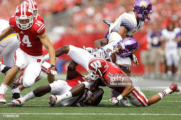 Ladarius Vanlier of the Tennessee Tech Golden Eagles gets tackled by Leon Jacobs and TJ Reynard of the Wisconsin Badgers during the game at Camp...