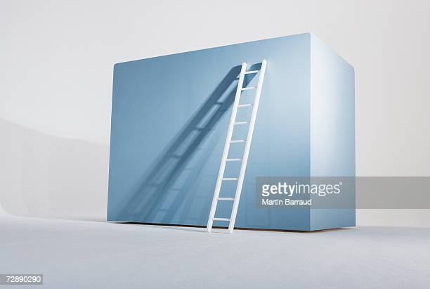Ladder against empty giant box