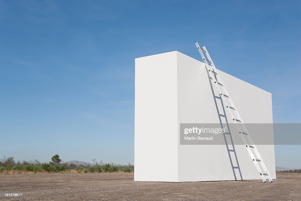Ladder against white wall outdoors : Stock Photo