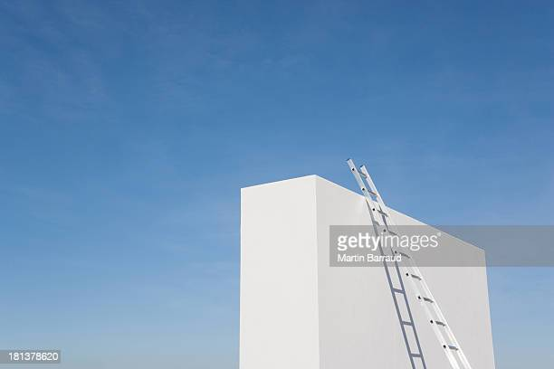 Ladder against white wall outdoors
