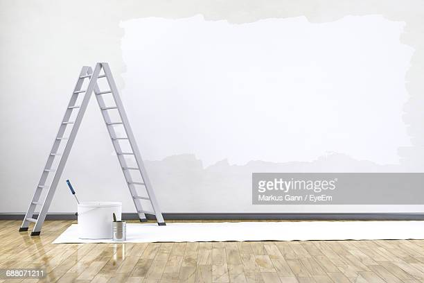 ladder and painting equipment indoors - dipingere foto e immagini stock