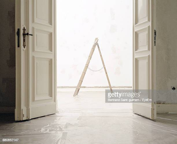 Ladder At Doorway In Empty House