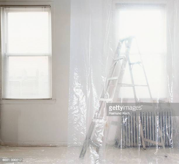Ladder behind Plastic Sheeting