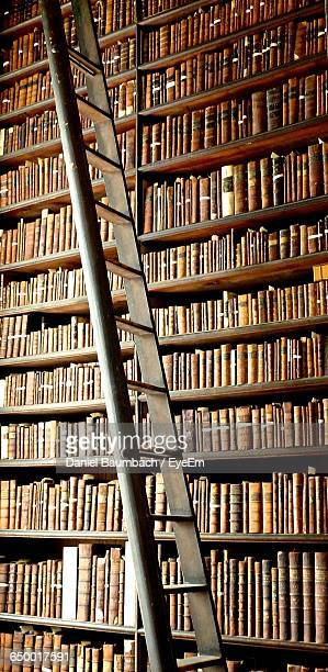 Ladder By Books In Shelves At Trinity College
