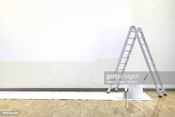 Ladder By Containers On Floorboard By Wall At Home