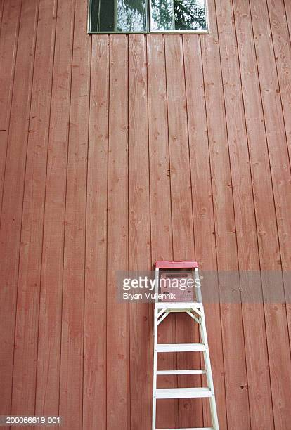 Ladder leaning up against side of house