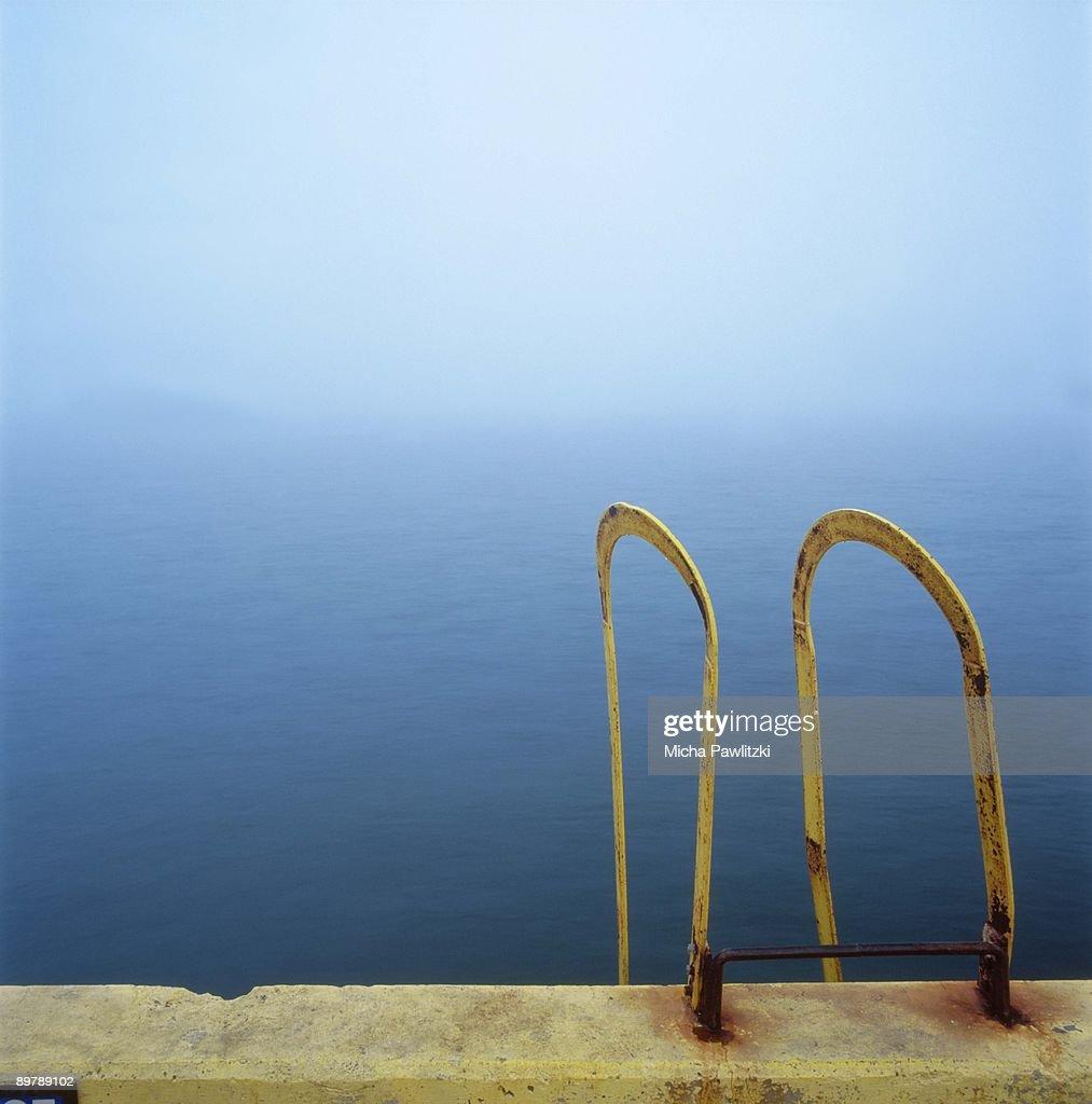 Ladder near ocean : Stock Photo