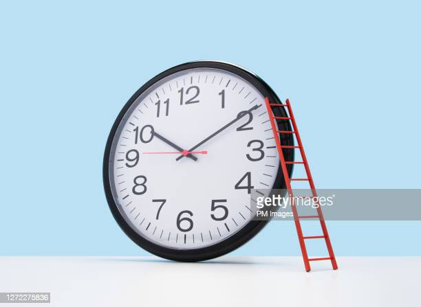 ladder on a clock - time stock pictures, royalty-free photos & images