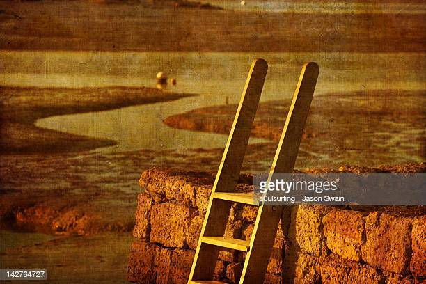 ladder on red stone wall in golden light - s0ulsurfing stock pictures, royalty-free photos & images