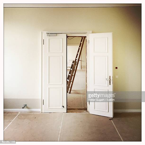 ladder seen through ajar door at home - ajar stock pictures, royalty-free photos & images