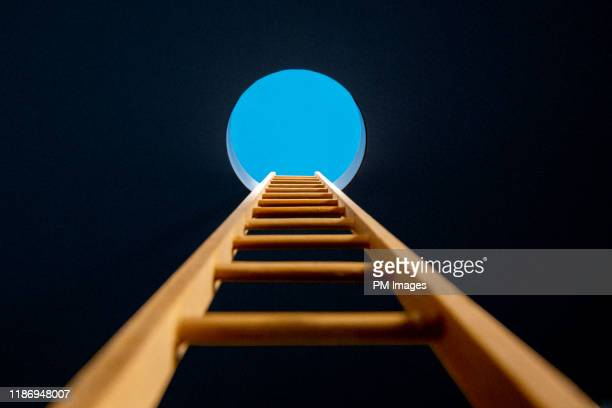 ladder though hole in ceiling - beginnings stock pictures, royalty-free photos & images