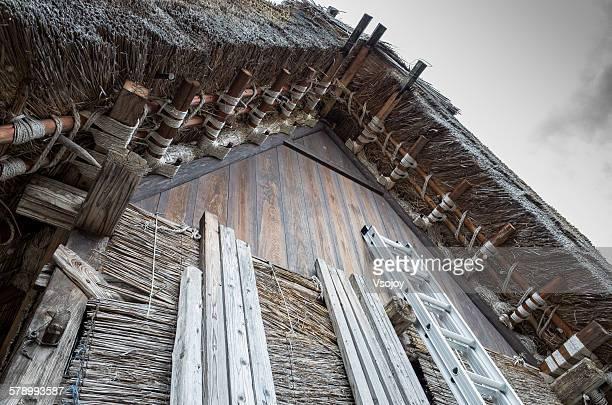 ladder to the gassho-zukuri roof, shirakawa-go - vsojoy stock pictures, royalty-free photos & images