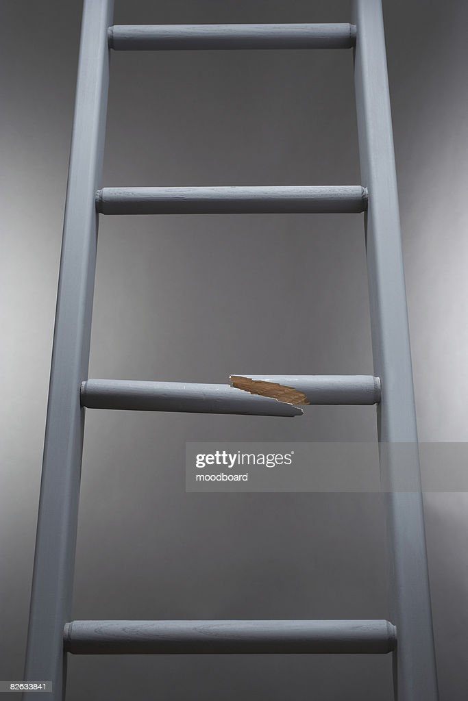 Ladder with one step broken : Stock Photo