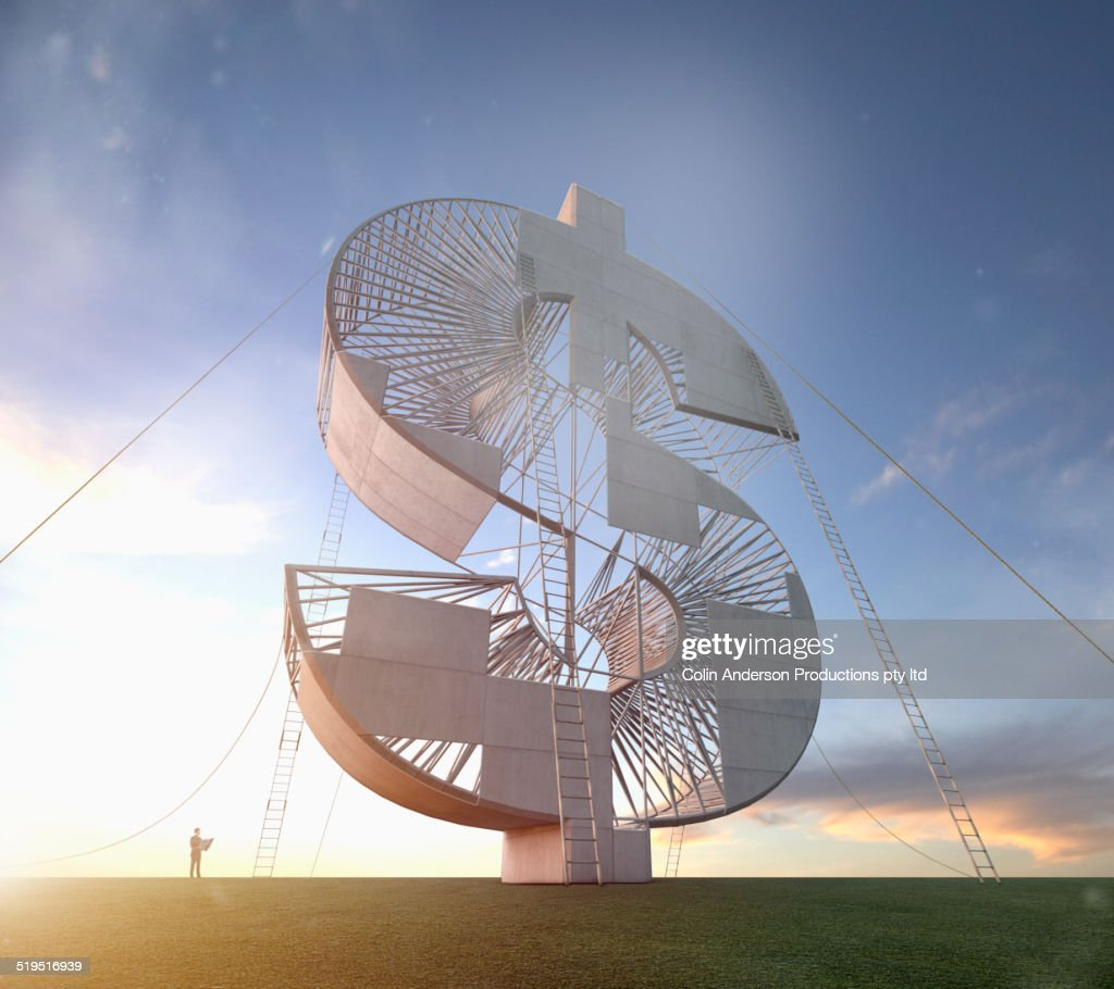 Ladders leaning on enormous dollar sign under construction : Stock Photo