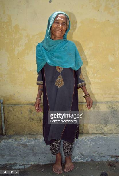 Laddo stands while her her photograph is taken October 1 1997 in New Delhi India Laddo a housecleaner is from the Dalit or Untouchable caste group...
