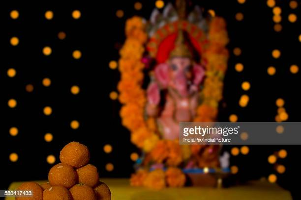 laddus and ganesh idol - mithai stock pictures, royalty-free photos & images