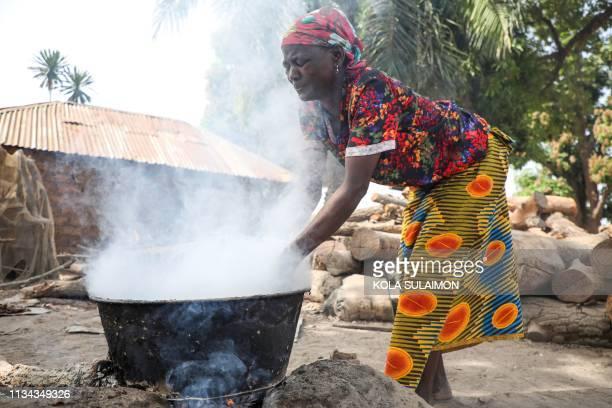 Ladi Kodi a monthly beneficiary of Conditional Cash Transfer programme works to make black soap in Garaku Kokona Local Government Nasarawa North...