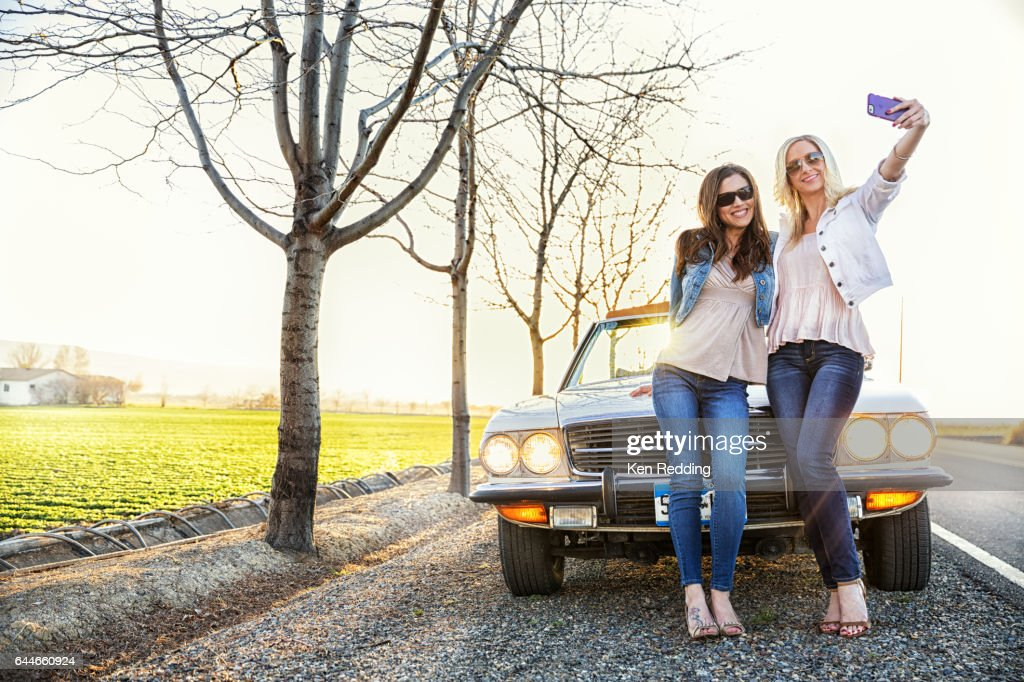 2 Ladies and a car : Stock Photo