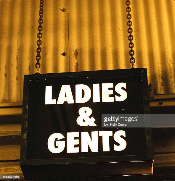 ladies and gents neon sign on chain - lyn holly coorg stock pictures, royalty-free photos & images