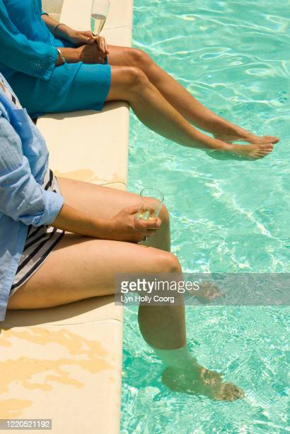 ladies bare legs in swimming pool - lyn holly coorg stock pictures, royalty-free photos & images