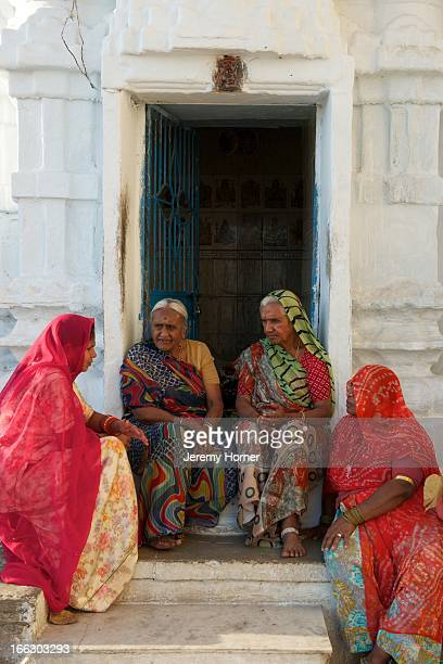 Ladies chat on Gangaur Ghat the city centre's main access point to Lake Pichola