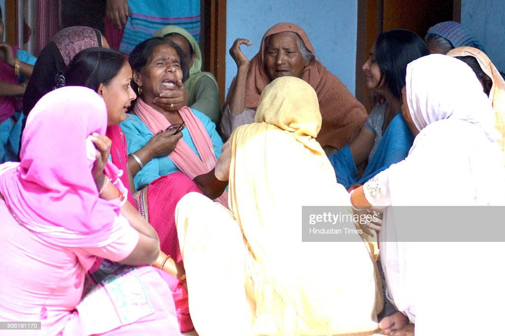 Ladies consoling Harbans Kaur mother and Usha wife of Surjit who died in Iraq at their residence in village Chuharwali on March 20 2018 near...