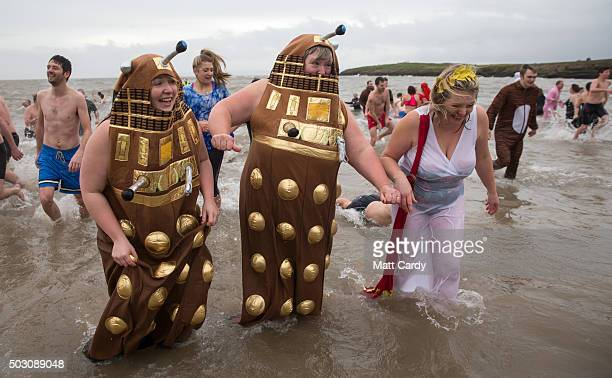 Ladies dressed as Daleks run from the sea as they take part in the annual New Year's Day swim at Barry Island as several hundred swimmers marked...