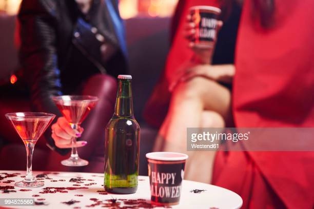 ladies drinking at a party - halloween party stock photos and pictures