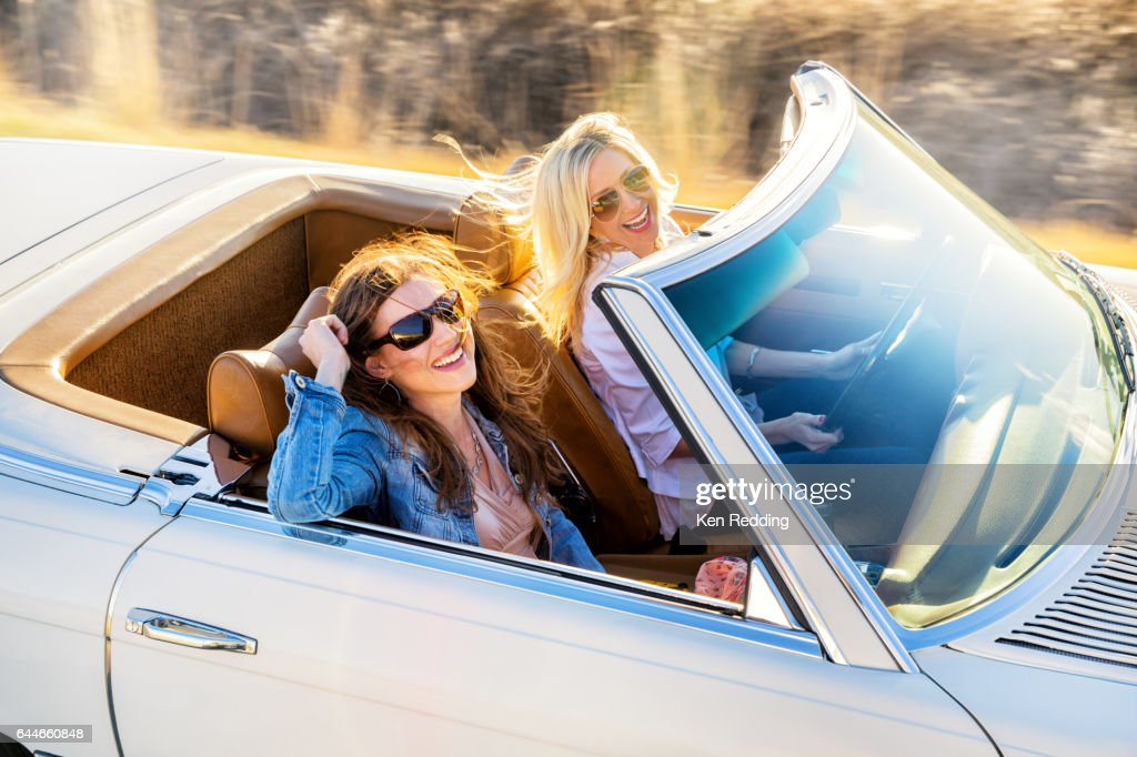 2 Ladies Driving in a Vintage Convertible : Stock Photo