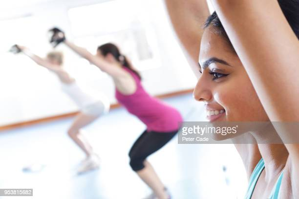 Ladies exercising in class