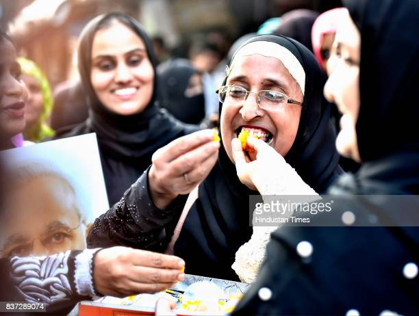 Ladies from Muslim community celebrate after verdict given by the Supreme Court for banning Triple Talaq at Byculla on August 22 2017 in Mumbai India...