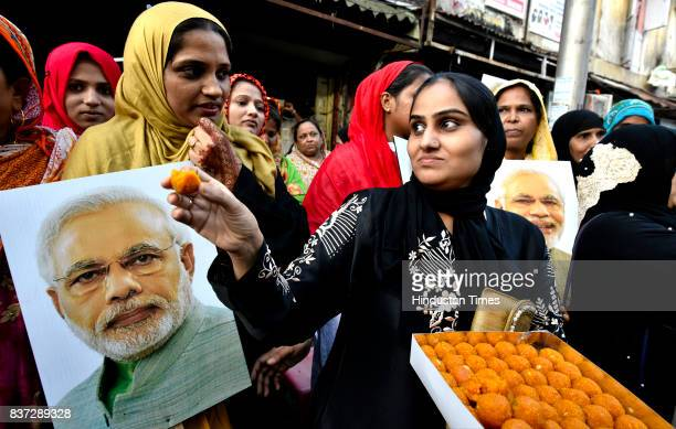 Ladies from Muslim community celebrate after verdict given by the Supreme Court for banning Triple Talaq on August 22 2017 in Mumbai India In a 32...