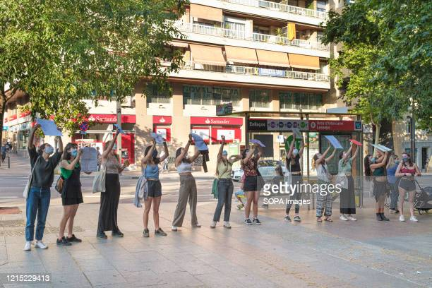 Ladies hold placards outside their friend's house wishing her happy birthday during the First Day of Phase 1 The measures of confinement in Spain are...