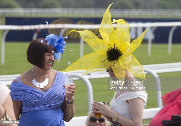 Ladies in fancy hats during Stobo Castle Ladies Day at Musselburgh Racecourse East Lothian