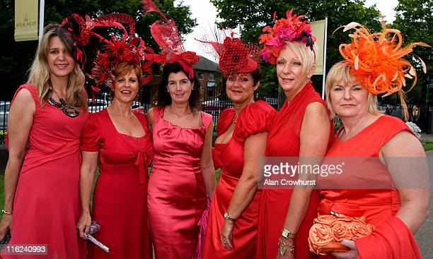 Ladies in red during day two of Royal Ascot at Ascot racecourse on June 15 2011 in Ascot England