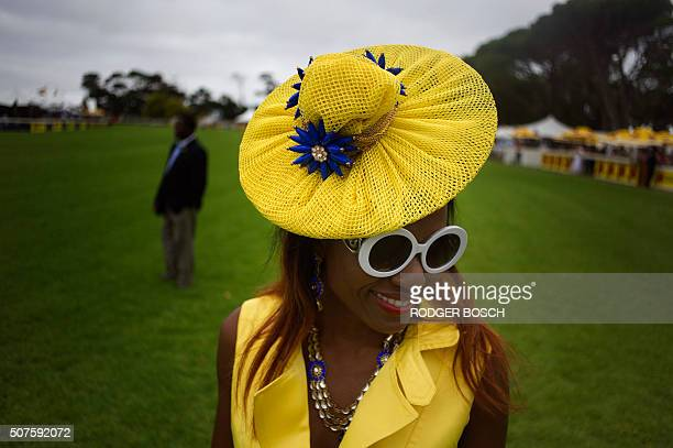 TOPSHOT Ladies in their hats are dressup for the running of the 39th JB Met horse race on January 30 at the Kenilworth Race Course in Cape Town The...