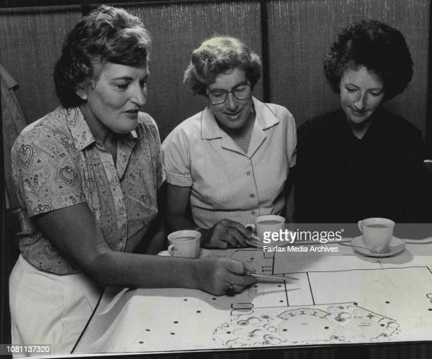 Ladies Looking At Plans For New Building With Cups of TeaL to R Mary Guthrie Mary Pulsford Penny PalmerMary Guthrie Mary Pulsford and Penny Palmer of...