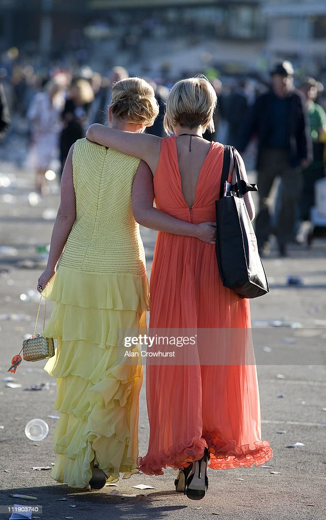 Ladies make their way home at Aintree racecourse on April 08, 2011 in Liverpool, England .