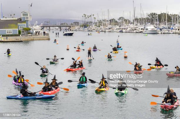 Ladies of OC Beaches bewitch the Dana Point Harbor as they have some pre-Halloween fun on Saturday, October 23, 2021.